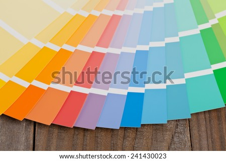 Color chart guide on wooden surface