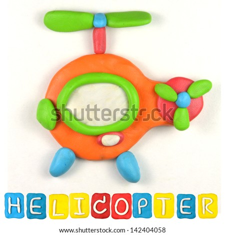 Color children's helicopter plasticine on a white background