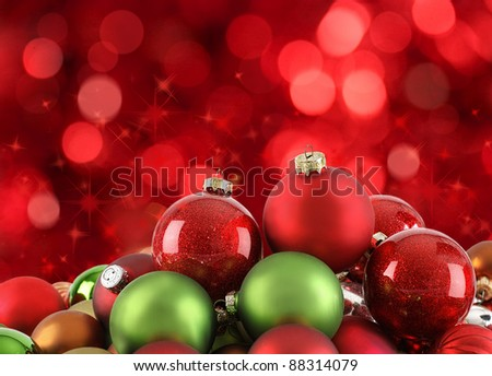 Color Christmas ornaments on abstract light background