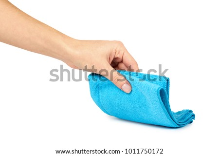 Color cleaning rag in hand isolated on white background