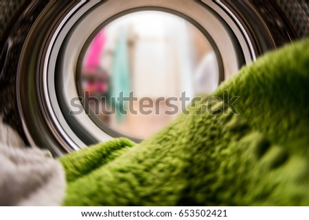 Color clothes in washing machine. inside view #653502421