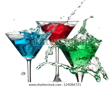 Color cocktails in martini glasses splash