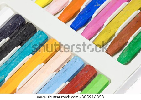Color Crayons In A Box on white background.