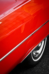 Color detail of the back wheel of a vintage red car