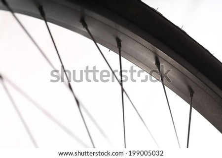 Color detail of the rim of a bicycle wheel, with spokes. #199005032