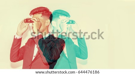 color double exposure.,Businessman observing with binoculars.,handsome man,Hipster looking to the future.,Business and finance concept,business concept #644476186