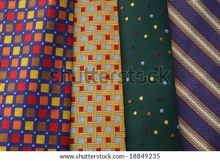 Color DSLR image of multi-colored neck ties in horizontal orientation. Good for background and fashion.