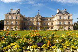 Color DSLR landscape picture of the Palace in Luxembourg Gardens, Paris, France; with colorful flowers and copy space for text.  Popular with tourists and Parisians, though no people are seen.