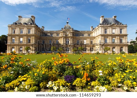 Color DSLR landscape picture of the Palace in Luxembourg Gardens, Paris, France; with colorful flowers and copy space for text.  Popular with tourists and Parisians, though no people are seen. #114659293