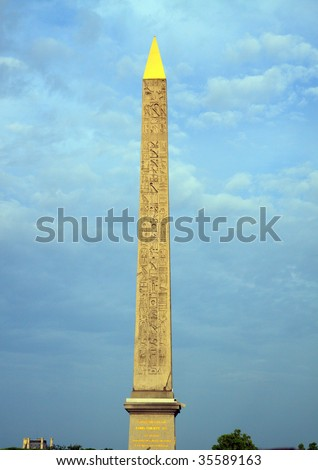 Color DSLR picture of Egyptian  Luxor Obelisk in the Place de la Concorde, Paris, France.  Lit by setting sun with dramatic sky, tourist destination is vertical with copy space for text.