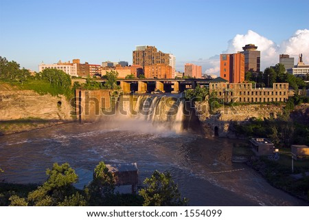 Color DSLR picture of High Falls waterfall in the city of Rochester, New York, at sunset.  The urban cataract is on the Genesee River; in horizontal orientation with copy space for text