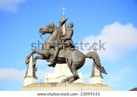 Color DSLR picture of statue of President Andrew Jackson on a horse, in Jackson Square, New Orleans, Louisiana, with the spires of St. Louis Cathedral in the French Quarter background