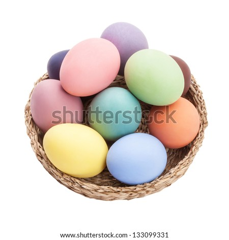 color eggs in wicker basket for holiday easter on white background - stock photo