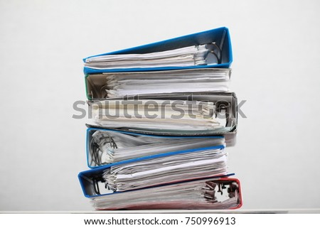 color folders with documents office paper stacks #750996913
