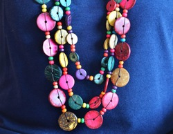 Color full beaded necklace on blue fabric natural light