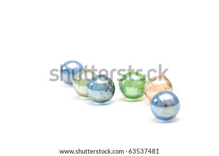 color glass balls lying on a table