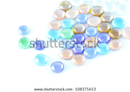 Color glass marble on white background.