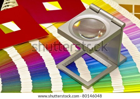 Color guide for offset print with a magnifier lens over the table