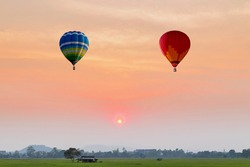 color hot air balloon in beautiful sky at sunset background