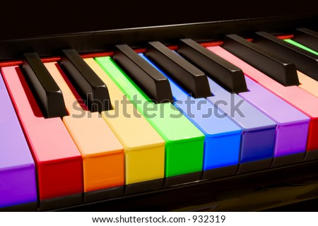 Color isolated piano keys in the colors of the rainbow.