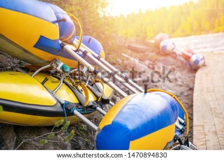 Color kayaks for rafting on tropical mountain river.