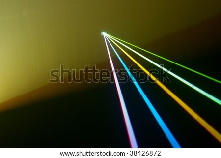 Color laser beams fantail in a haze