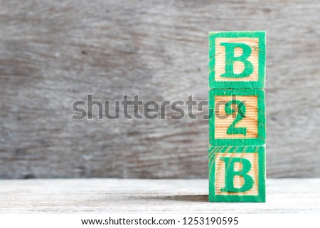 Color letter block in word b2b (abbreviation of business to business) on wood background