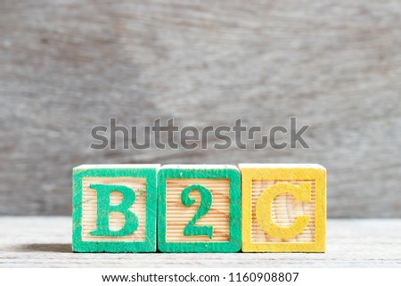 Color letter block in word b2c (abbreviation of business to consumer) on wood background