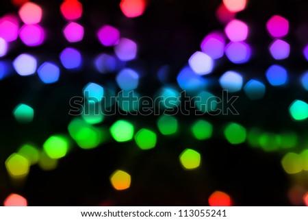 Color light bokeh over dark background