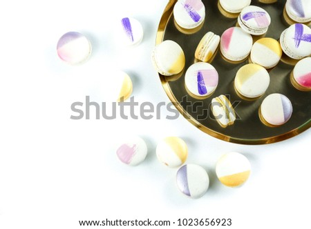 Color macaron cookies on a golden tray #1023656923