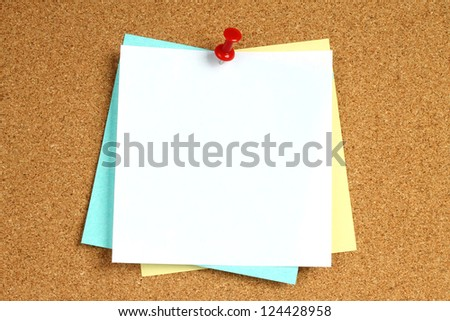 Color notes with pin on wooden background