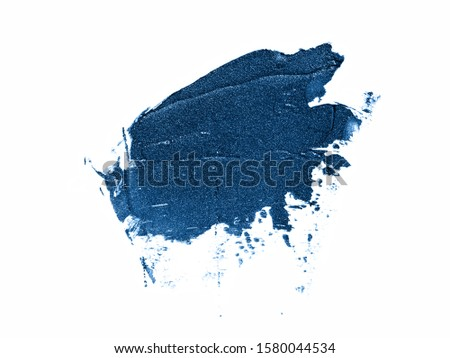 Color of the year 2020 classic blue glitter texture. Sample of classic blue makeup products isolated on white background. Trendy blue makeup, cosmetics concept. Main color trend concept.