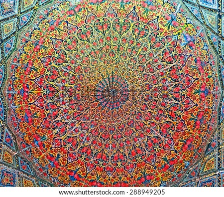 Color Painting Ancient Traditional Persian Style Mural Roof Painting at Pink Mosque in Shiraz, Iran on Sandstone Texture