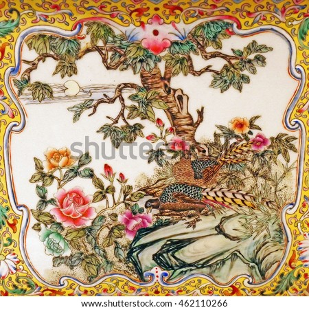 Color Painting Old Thai Traditional Colorful Porcelain Pattern of Beautiful Birds and Flowers on Sandstone Texture