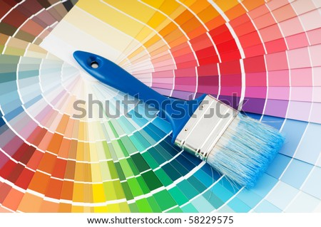 color palette guide and paint brush with blue handle