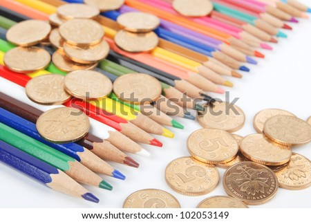 Color pencil and coin
