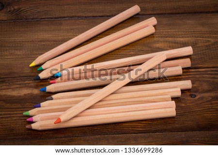 color pencil on wooden background.Crayons. Colored Pencils. colored pencils.