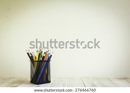 Color pencils and book on wooden background - Vintage effect style pictures