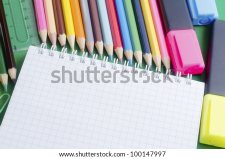 color pencils and note