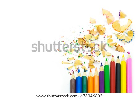 Color pencils and shavings on white background #678946603