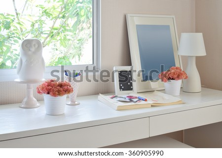 color pencils and sketchbook on wooden table in kids room #360905990