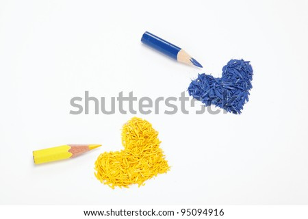 Color pencils and two hearts isolated on white background.