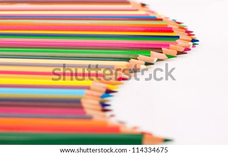 Color pencils arranged in a wave