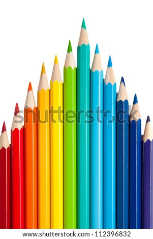 color pencils as a peak or arrows isolated on a white background