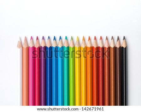 Color pencils composition on white background