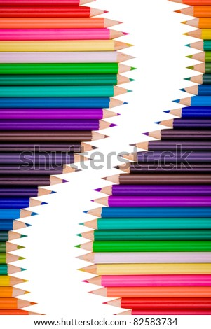 Color pencils crayons in arrange in color wheel colors on white background