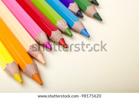 Color pencils crayons on paper background
