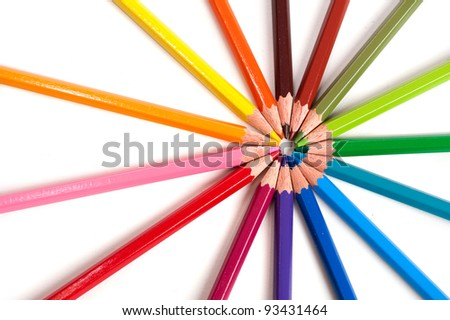 color pencils creating shape of circle on white background