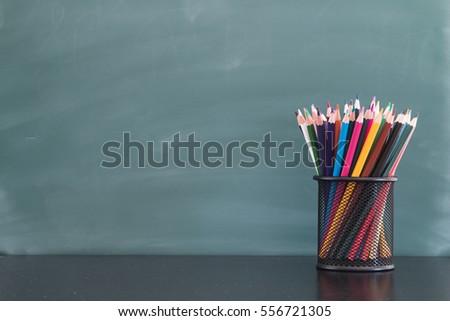 Color pencils facing the blackboard #556721305