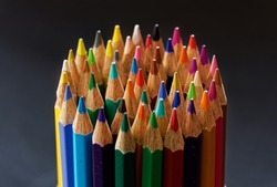 Color pencils heart isolated on black background close up with Clipping path.Beautiful color pencils.Color pencils for drawing Rainbow color pencil and used as a background.copy space for your image